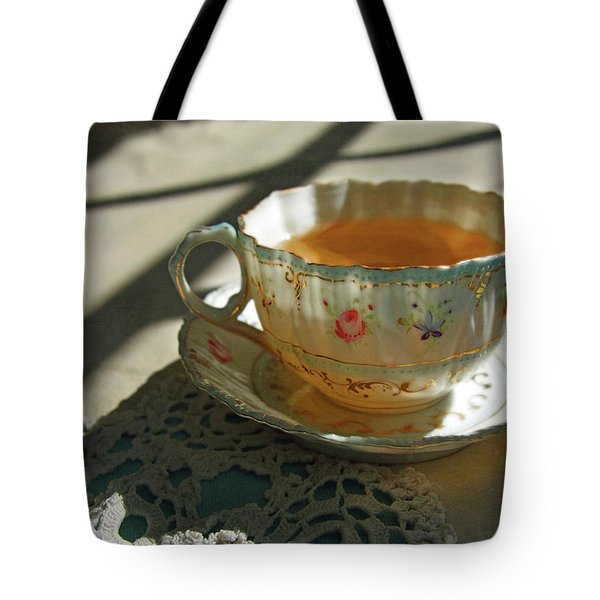 Tote Bag featuring the photograph Teacup On Lace by Brooke T Ryan