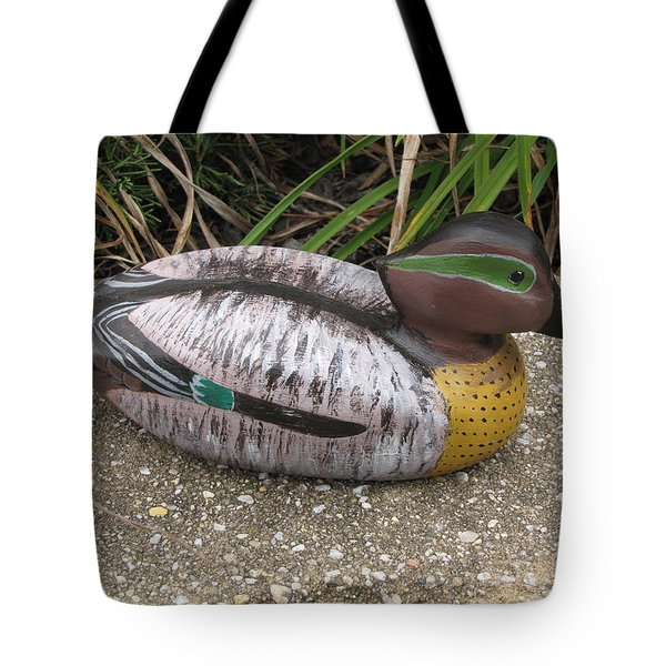 Tote Bag featuring the sculpture Teal Winged Male by Kevin F Heuman