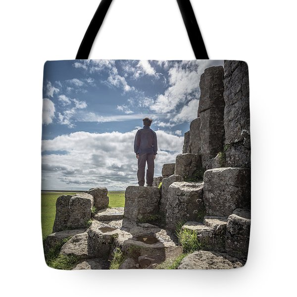 Tote Bag featuring the photograph Teen Boy Standing On Basalt Rocks by Edward Fielding