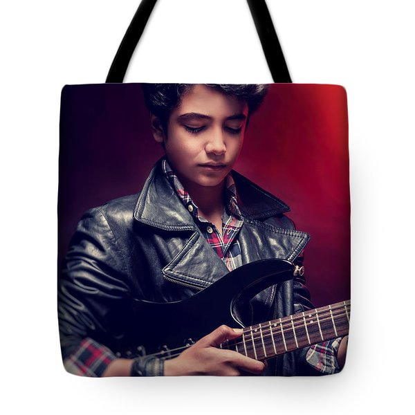 Teen Guy Playing On Guitar Tote Bag