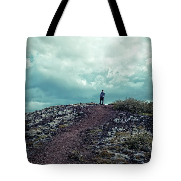 Tote Bag featuring the photograph Teenager On A Hiking Trail In Iceland by Edward Fielding