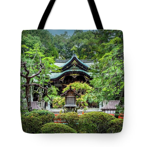 Tote Bag featuring the photograph Temple In The Rain by Rikk Flohr