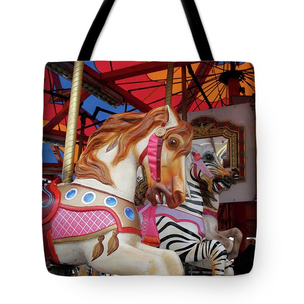 Tote Bag featuring the photograph Tented Carousel by Lesley Spanos