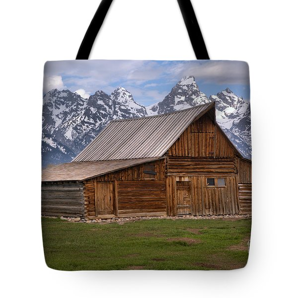 Tetons Towering Over The Moulton Barn Tote Bag by Adam Jewell