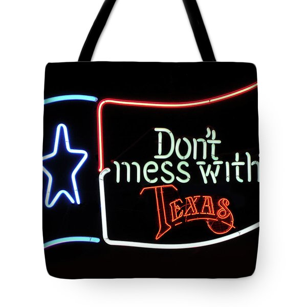 Tote Bag featuring the photograph Texas Flag Saloon Neon by Daniel Hagerman