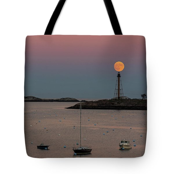 The 2016 Supermoon Balancing On The Marblehead Light Tower In Marblehead Ma Tote Bag