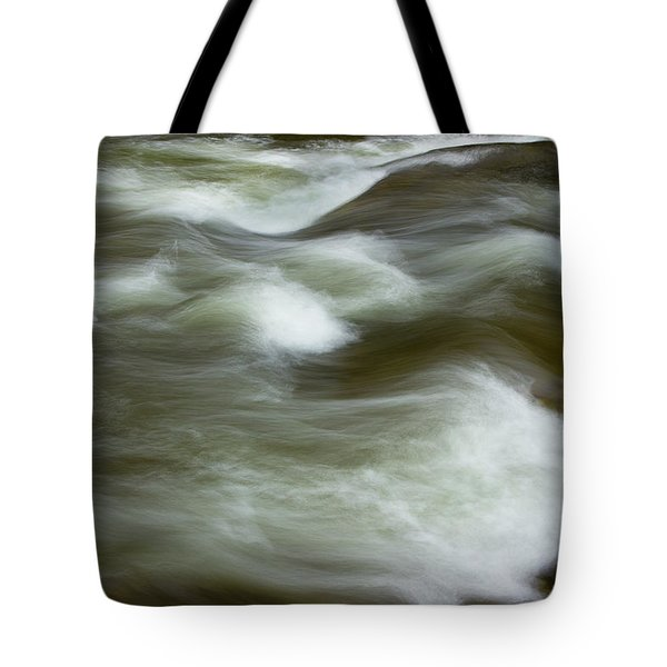 Tote Bag featuring the photograph The Action On Top by Mike Eingle