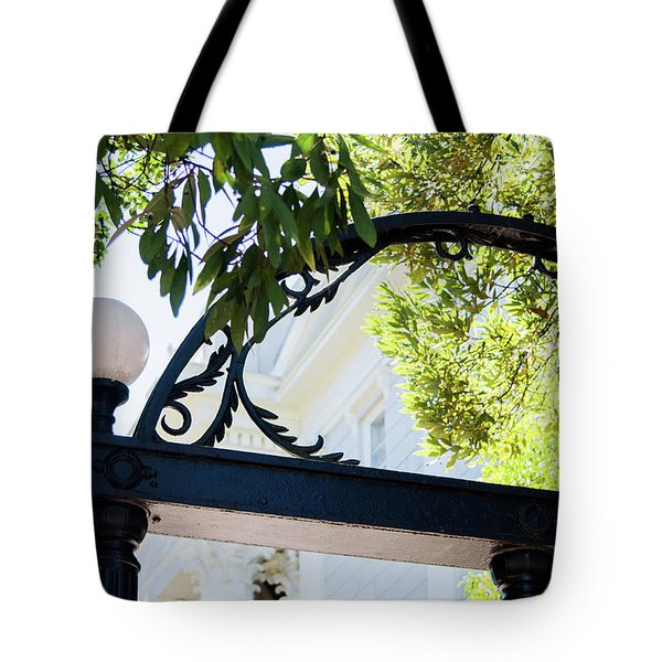 Tote Bag featuring the photograph The Arch by Parker Cunningham