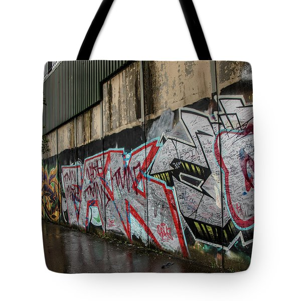 Tote Bag featuring the photograph The Belfast Peace Wall by Teresa Wilson