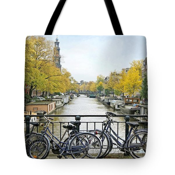 Tote Bag featuring the photograph The Bicycle City Of Amsterdam by David Birchall
