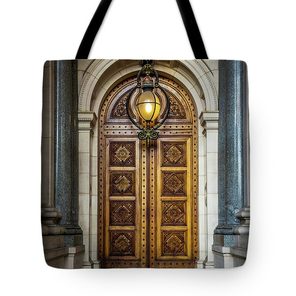 Tote Bag featuring the photograph The Big Doors by Perry Webster