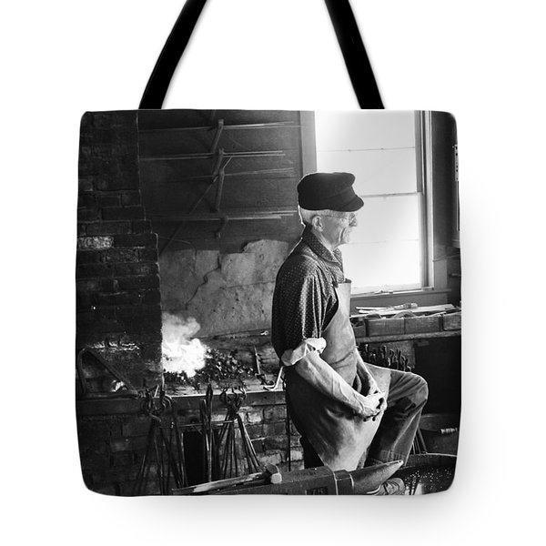 Tote Bag featuring the photograph The Blacksmith  by Ricky L Jones