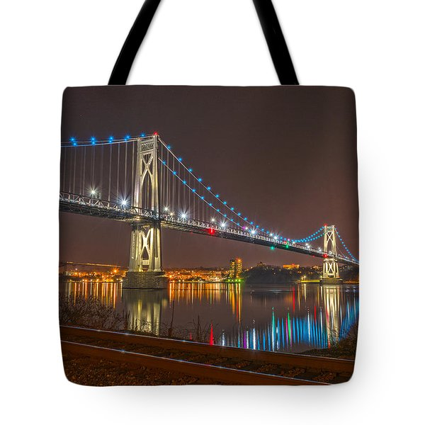 The Bridge With Blue Holiday Lights Tote Bag by Angelo Marcialis