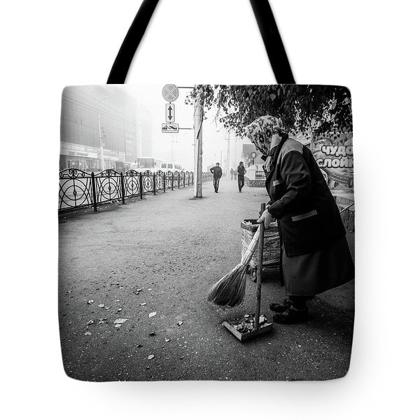 Tote Bag featuring the photograph The Cleaner Of Leaves by John Williams