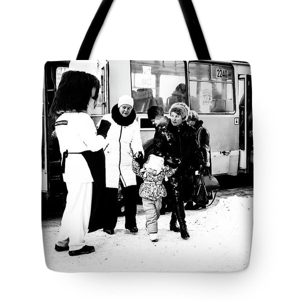 Tote Bag featuring the photograph The Collector Of Smiles by John Williams