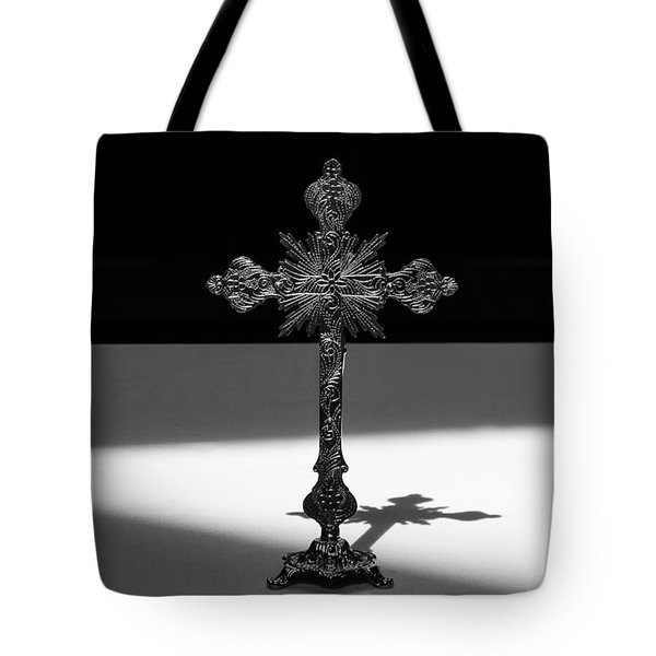 Tote Bag featuring the photograph The Cross's Shadow by Monte Stevens