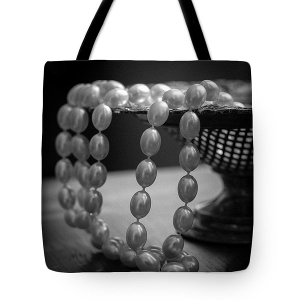 Tote Bag featuring the photograph The Drama Of Pearls by Patrice Zinck