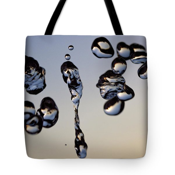 Tote Bag featuring the photograph The Droplets by Rico Besserdich
