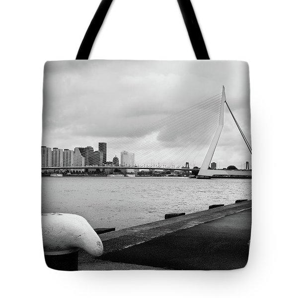 Tote Bag featuring the photograph The Erasmus Bridge In Rotterdam Bw by RicardMN Photography