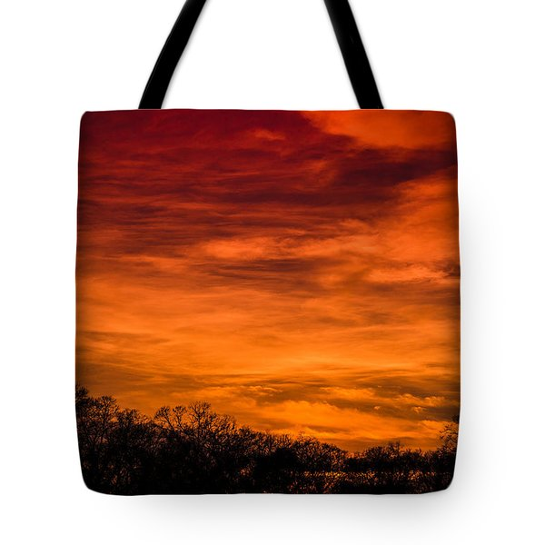 The Evening Sky Of Fire Tote Bag by David Collins