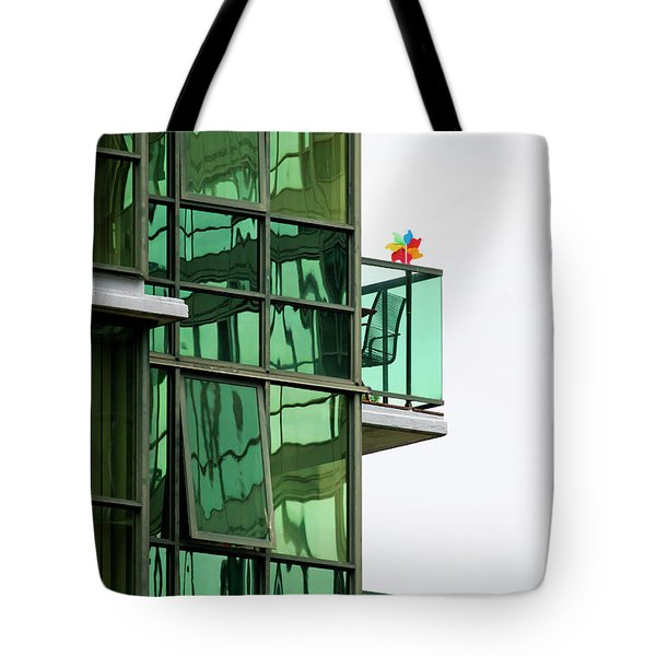 Tote Bag featuring the photograph The Windmill by Chris Dutton