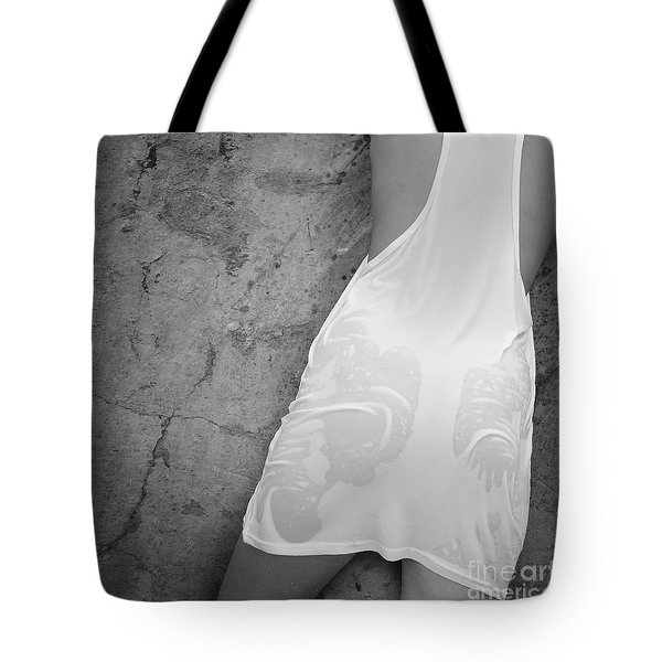 Tote Bag featuring the photograph The Figure Of A Young Girl In A Wet Dress. by Andrey  Godyaykin