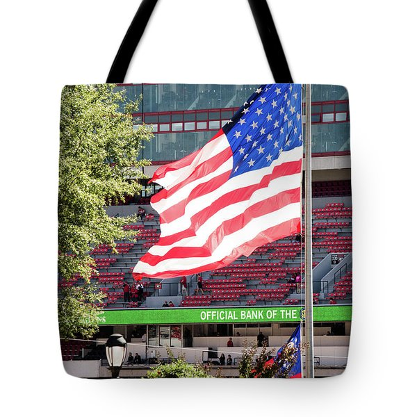 Tote Bag featuring the photograph The Flag Flying High Over Sanford Stadium by Parker Cunningham