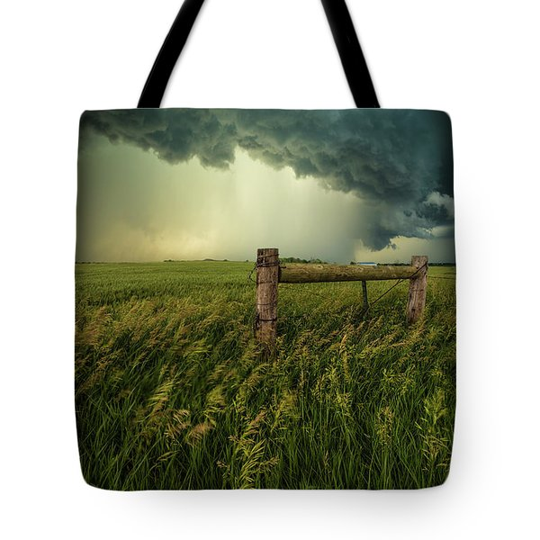 Tote Bag featuring the photograph The Frayed Ends Of Sanity  by Aaron J Groen