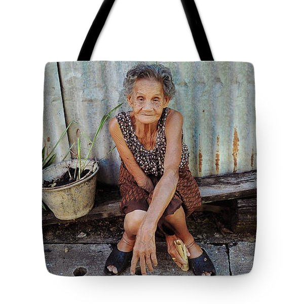 Tote Bag featuring the photograph The Gardener by Jeremy Holton
