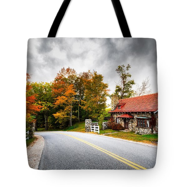 Tote Bag featuring the photograph The Gate Keeper by Robert Clifford
