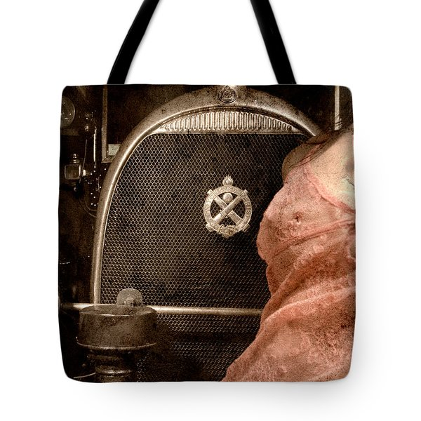 Tote Bag featuring the photograph The Girl On The Background Of Vintage Car. by Andrey  Godyaykin