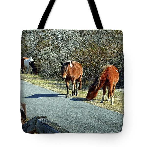 Tote Bag featuring the photograph The Grass Is Always Greener by Assateague Pony Photography