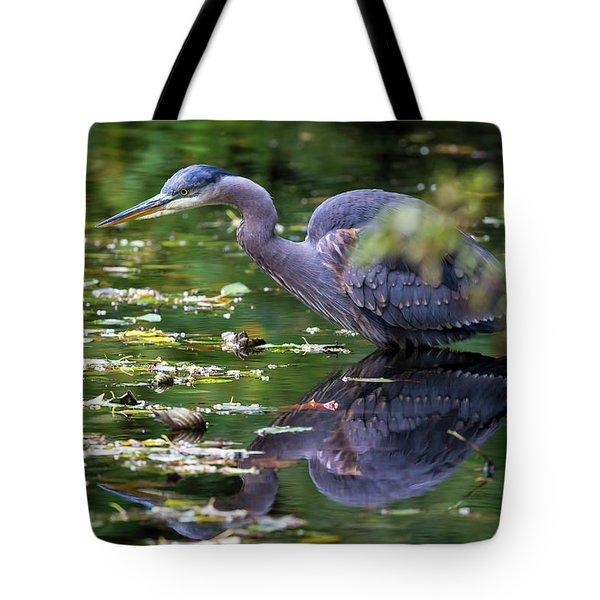 The Great Blue Heron Hunting For Food Tote Bag by David Gn