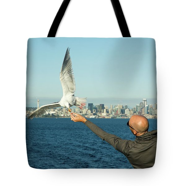 The Hand That Feeds You. Tote Bag