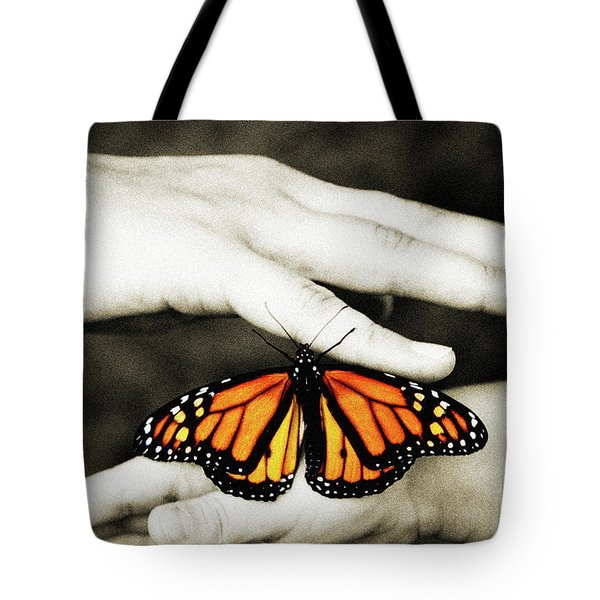 The Hands And The Butterfly Tote Bag by Andee Design