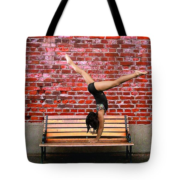 Tote Bag featuring the photograph The Handstand by Robert Hebert