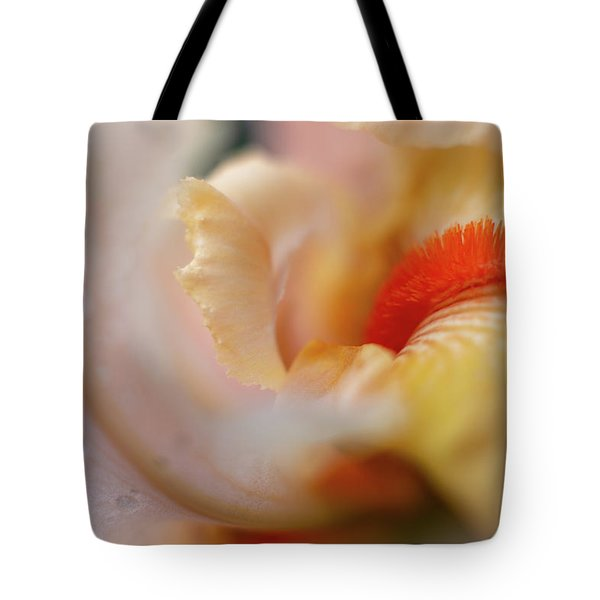 Tote Bag featuring the photograph The Heart Of A Yellow Iris by Francisco Gomez
