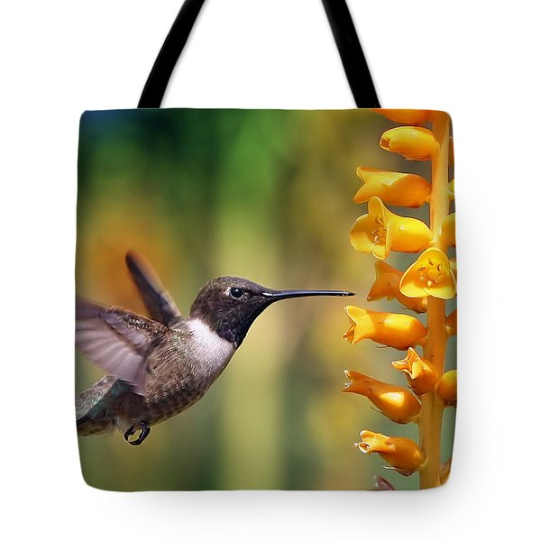 Tote Bag featuring the photograph The Hummingbird And The Bee by William Lee