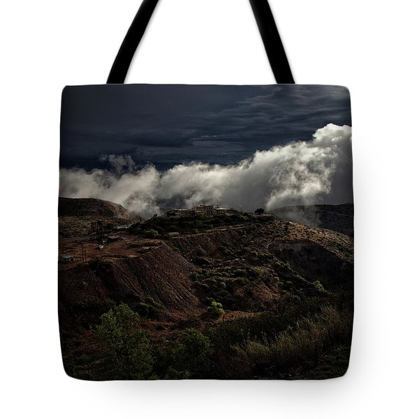 Tote Bag featuring the photograph The Jerome State Park With Low Lying Clouds After Storm by Ron Chilston