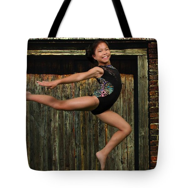 Tote Bag featuring the photograph The Jump by Robert Hebert