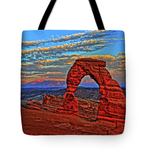 Tote Bag featuring the photograph The La Sal Mountains And Arch by Scott Mahon