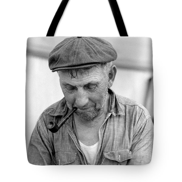 Tote Bag featuring the photograph The Pipe Smoker by John Stephens