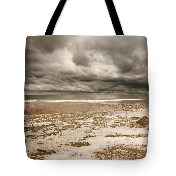 Tote Bag featuring the photograph The Last Sand Castle Of The Season by Jim Moore