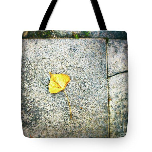 Tote Bag featuring the photograph The Leaf by Silvia Ganora