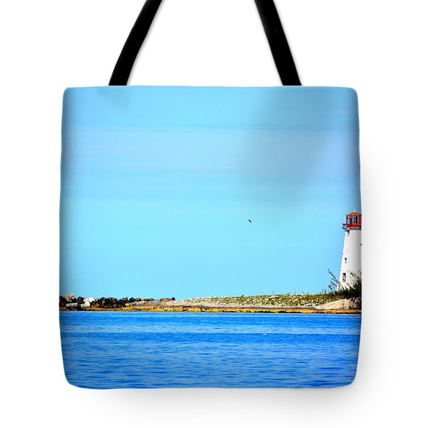 The Lighthouse At Sea Tote Bag