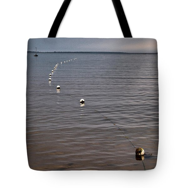 Tote Bag featuring the photograph The Line by Jouko Lehto