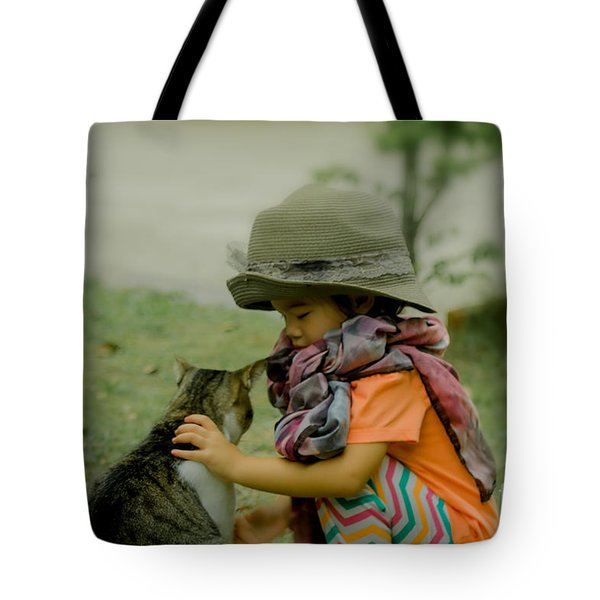 The Little Girl And Her Cat Tote Bag