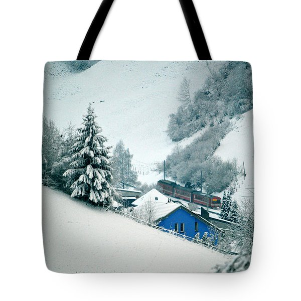Tote Bag featuring the photograph The Little Red Train - Winter In Switzerland  by Susanne Van Hulst