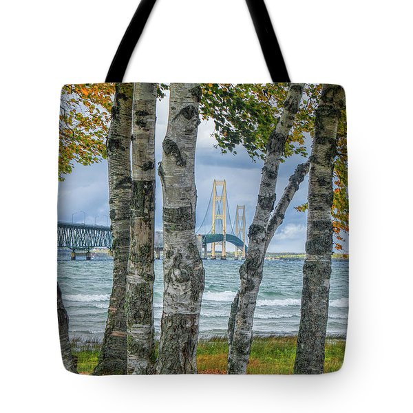 The Mackinaw Bridge By The Straits Of Mackinac In Autumn With Birch Trees Tote Bag
