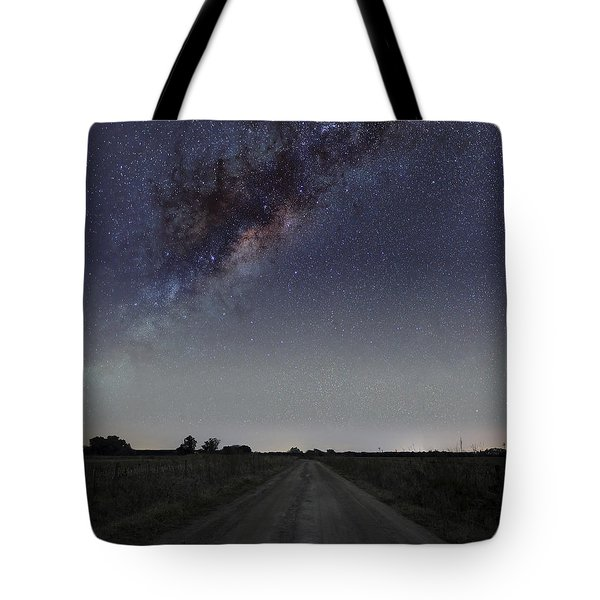 The Milky Way Galaxy Over A Rural Road Tote Bag by Luis Argerich